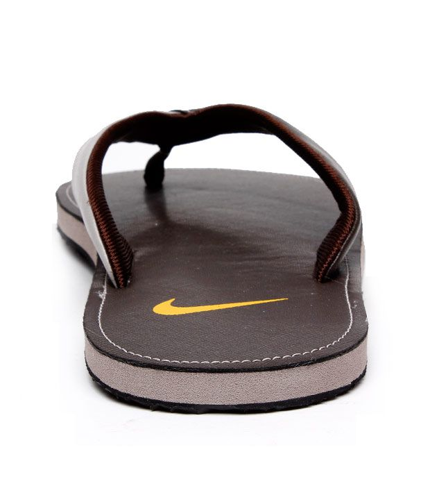 low priced 9438a 9d2cb Nike Classic Brown Slippers