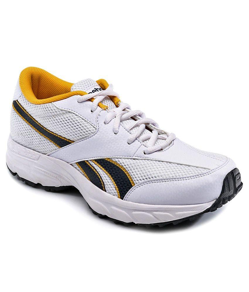 032daa20649a Reebok White   Yellow Sports Shoes Art RBJ92099ASSTDCROSSWHTNVYYLW - Buy Reebok  White   Yellow Sports Shoes Art RBJ92099ASSTDCROSSWHTNVYYLW Online at Best  ...