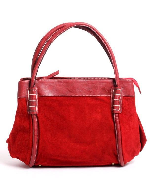 The bag comes with soft suede in a beautiful and vivid red colour and has natural leather trims, which helps the bag keep its silhouette. An ethnic hand-woven cloth is featured on the front which makes each of these bags a very limited edition.