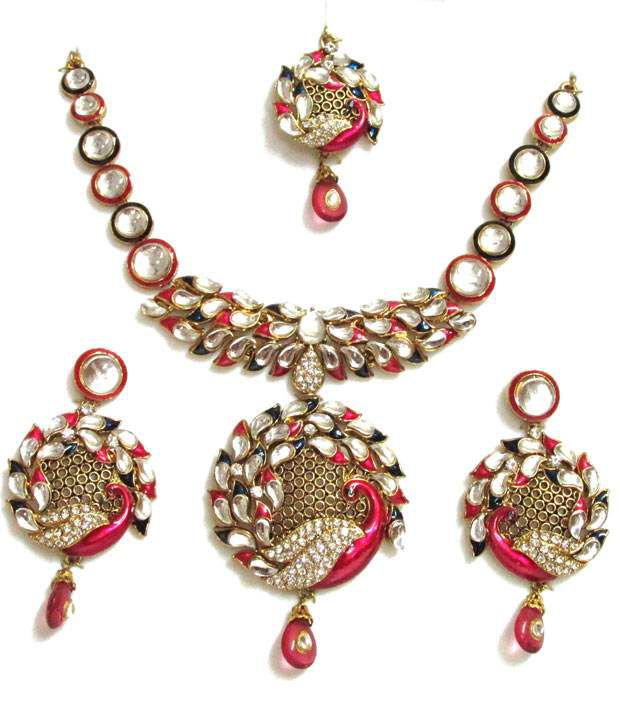 Mable Peacock Design Kundan Set With Pink And Blue Minakari Work In It .