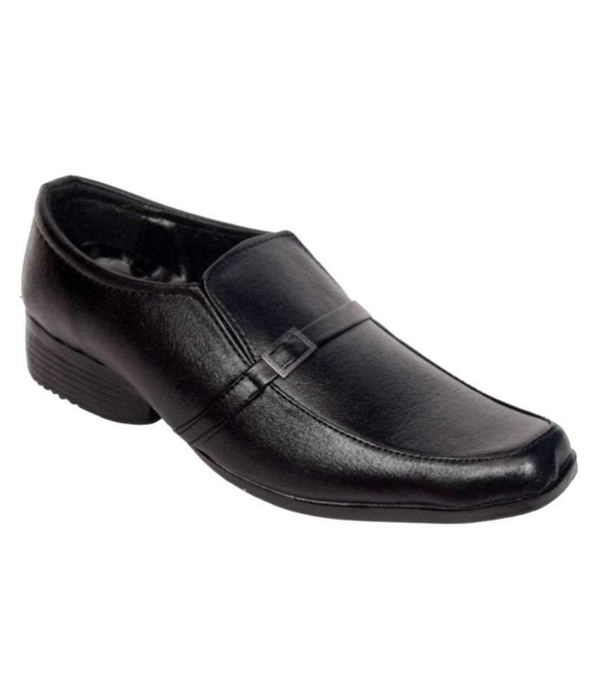 cyro black slip on non leather formal shoes price in india
