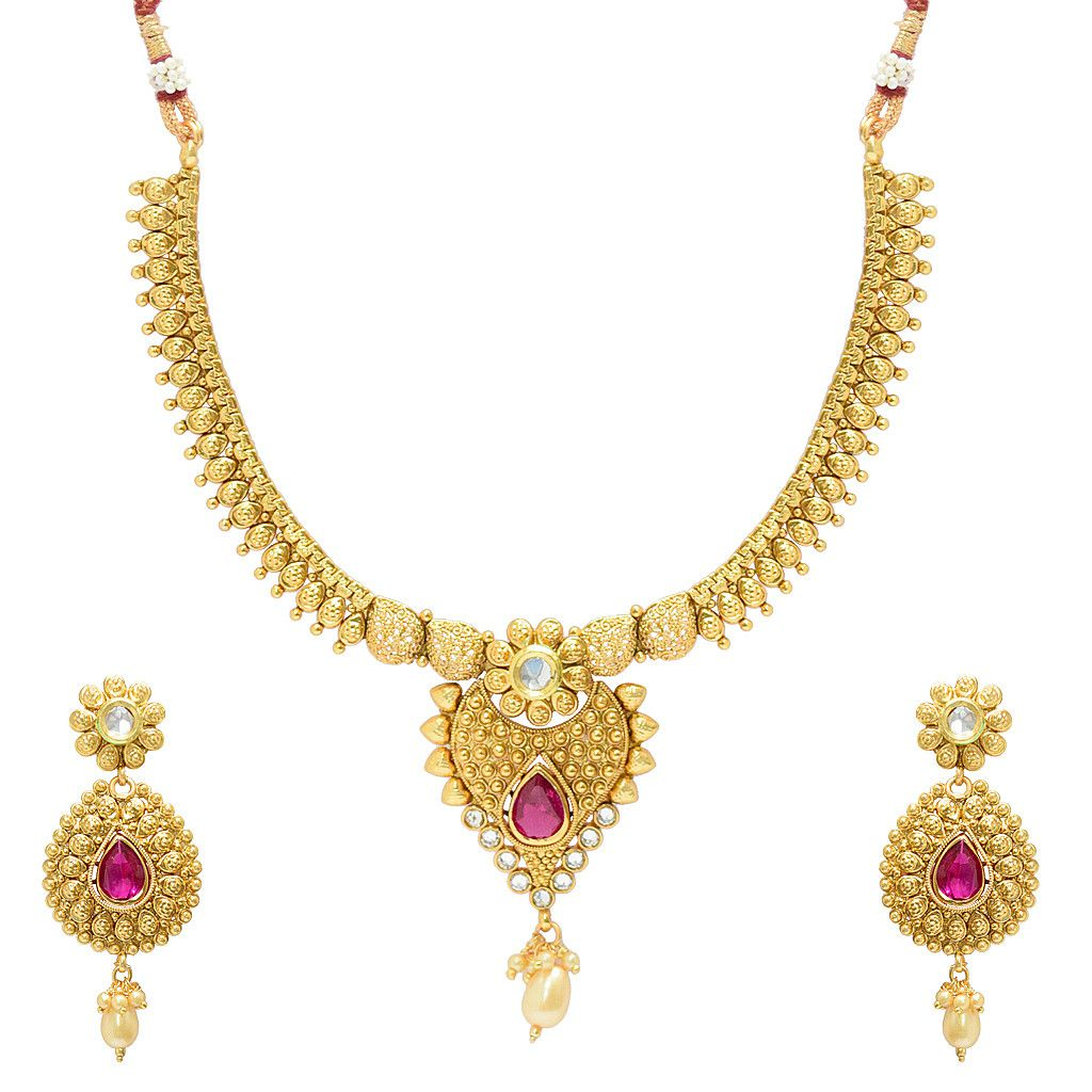 Golden traditional necklace set with red stone