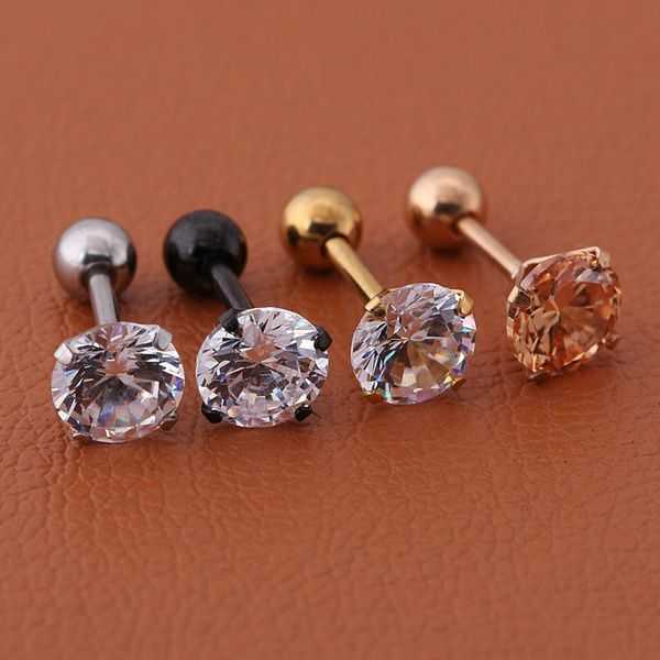 Titanium steel earring stud with gold-plated gemstones. For body jewelry fans.
