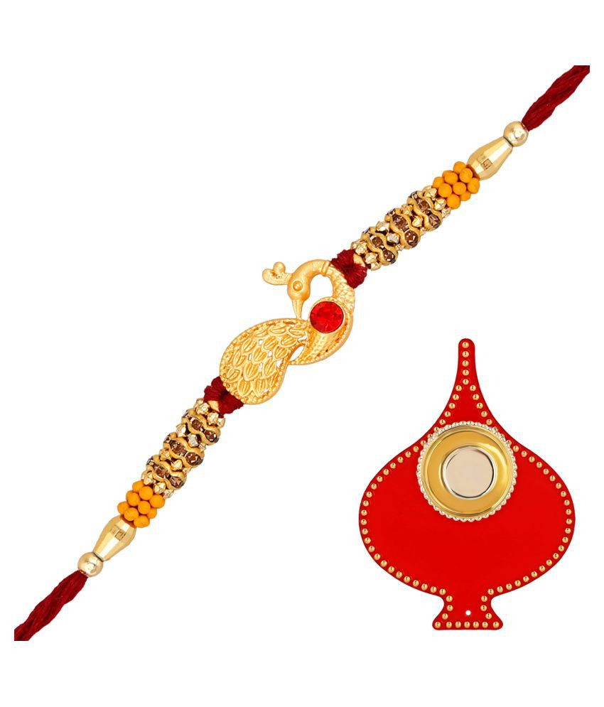 Rakhi Gift: Om Jewells Matte Gold Platted Luxurious Delicate Feathery Peacock Rakhi (Bracelet) Decorated with Red and LCT Stones with Red Tilak Plate for Loving Bhaiya/Brother RK1000325